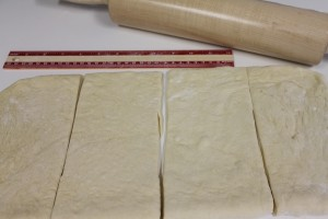 Cutting strips of dough for a layered effect. 