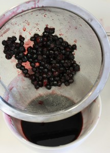 Heat berries and strain them. Don't mash!! Be gentle.