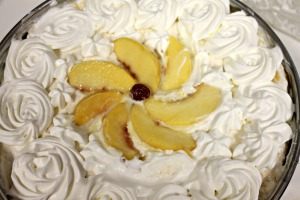 Top with whipped cream. Add peaches before serving.