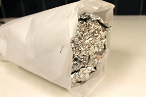 Cover the foil with parchment.