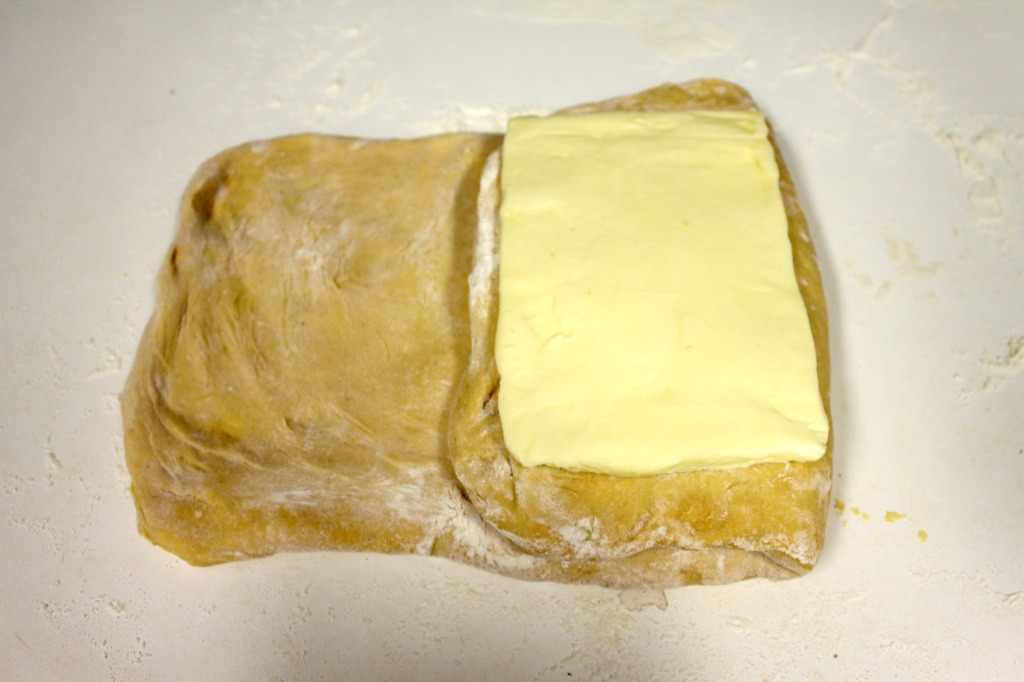 Fold right side over and cover with 2nd piece of butter. Then fold left over butter and seal.