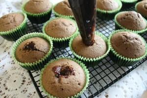 Filling the cupcakes with Irish Cream Ganache